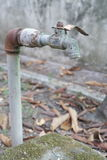 Old Decayed Faucet. With rusty pipe Stock Photography