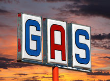 Old Decayed Gas Sign with Sunset Sky Stock Photo