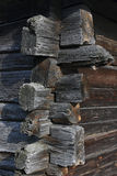 Old decayed wooden log house corner joint. Stock Images