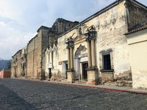 Old, decaying colonial architecture seen from the cobbled streets of the beautiful town of Antigua Guatemala, Guatemala. royalty free stock images