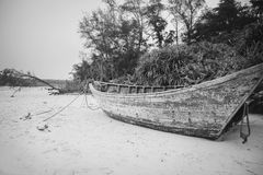 Old decaying fisherboat on beach Stock Photos