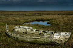 Old and decaying isolated wooden rowing boat Stock Photography
