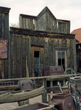 Old Western Wood Building. Old decaying western merchant wooden building with windows Royalty Free Stock Photos
