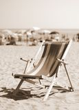Old deck on beach with many umbrellas in summer Royalty Free Stock Photos