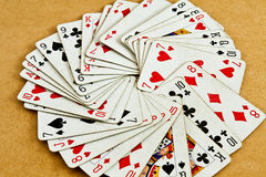 Old deck of cards. Old deck of playing cards on a wooden table stock photo