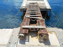 Old decking on the docks in the Sicilian port. Italy Stock Photography