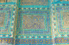 The old decor. SAMARKAND, UZBEKISTAN - May 1, 2015: The colorful tiled details on the wall of Ustad 'Ali Nafisi mausoleum in Shah-i-Zinda architectural complex Stock Images