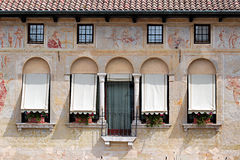 Old decorated facade with frescoes in Italy Stock Photo