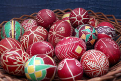 Old decorated red easter eggs in basket Royalty Free Stock Image