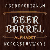 Old decorative alphabet vector font. Type letters on the dark wooden background. Royalty Free Stock Image
