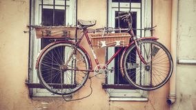 Old decorative bicycle on window stock photography
