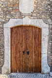 Old decorative door in a stone wall. Royalty Free Stock Photo