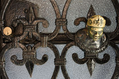 Old decorative element on a glass metal door, Venice Stock Images