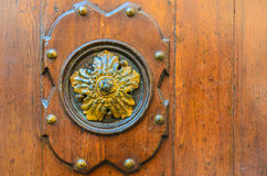 Old decorative element on a wooden door, Venice Stock Images
