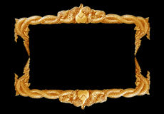 Old decorative gold frame - handmade, engraved - isolated on black background. Royalty Free Stock Photos