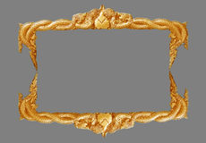 Old decorative gold frame - handmade, engraved - isolated on gray background. Stock Image