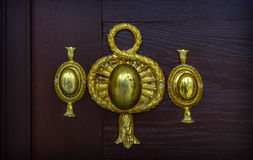 Old decorative golden door knob Royalty Free Stock Photography