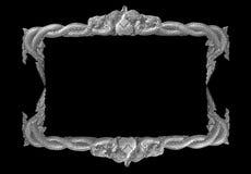 Old decorative gray frame - handmade, engraved - isolated on black background. Stock Photo