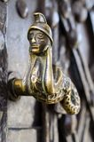 Old decorative handle, close up,at a medieval door Royalty Free Stock Image