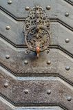 Old decorative handle, close up,at a medieval door royalty free stock photos