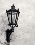 Old decorative lamp on a wall, Riga Stock Photos