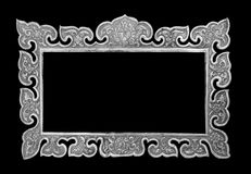 Old decorative silver frame - handmade. Engraved - isolated on black background Royalty Free Stock Photos