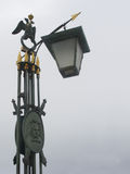 Old decorative streetlight. With birds, arrows and shields Royalty Free Stock Image