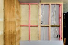 Home renovation. Building a new wall with plasterboard and treated timber stock photo