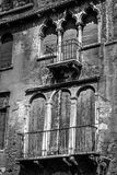 Old decrepit windows and doors in black and white Stock Photo