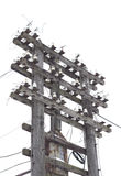 Old decrepit wooden telephone pole Royalty Free Stock Photos