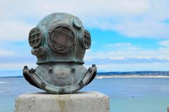 Old Deep Sea Diving Helmet. An old deep sea diving helmet commemorates the cannery divers who maintained the floating hoppers and underwater pipes that pumped Royalty Free Stock Photography