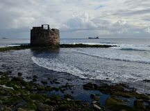 Old defensive tower by the sea stock photos