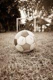 Old deflated soccer ball, old deflated football Stock Image