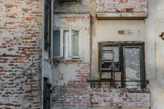 Old, degraded building in central area. Old, degraded building, not restored historical house with wooden windows royalty free stock photos