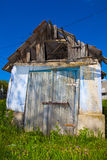 Old degraded house under blue sky Stock Photos