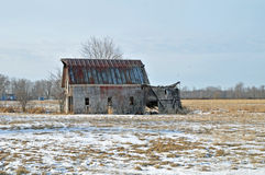Old delapidated barn. Image of an old delapitaded barn in winter Stock Photo