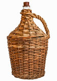 Old demijohn glass wrapped in wicker. Isolated on white Stock Images