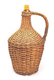 Old demijohn wicker wrapped glass bottle isolated on white. Background Stock Photography