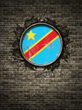 Old Democratic Republic of Congo flag in brick wall. 3d rendering of a Democratic Republic of Congo flag over a rusty metallic plate embedded on an old brick Royalty Free Stock Photos