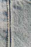 Old Denim. Macro of a seam in a favorite pair of old blue jeans Royalty Free Stock Photo