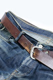 Old denim with leather belt, isolated Royalty Free Stock Photo