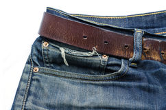 Old denim with leather belt Royalty Free Stock Photography