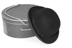Old derby hat with hat box in black & white. Isolated image of old derby hat with hat box in black & white Stock Photo