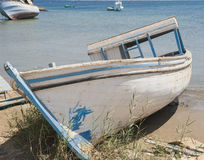 Old derelict boat abandoned on beach Royalty Free Stock Photos