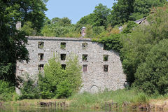 Old derelict mill. This is an old derelict mill situated on the banks of the River Lennon near the town of Ramelton in County Donegal,Ireland.The mill is built Royalty Free Stock Photography