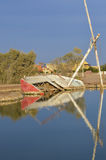 Old derelict sailing boat on river bank Stock Image