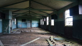 Old Derelict Sleeping Quarters. An old derelict building used during the war, photo shows the inside of the room that was used as the Soldier's sleeping quarters Stock Images