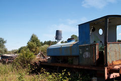 Old derelict train in overgrown field. Stock Photography