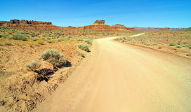 Old desert dirt road in monument valley utah Royalty Free Stock Images