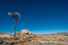 Old desert Farm Windmill Stock Photography